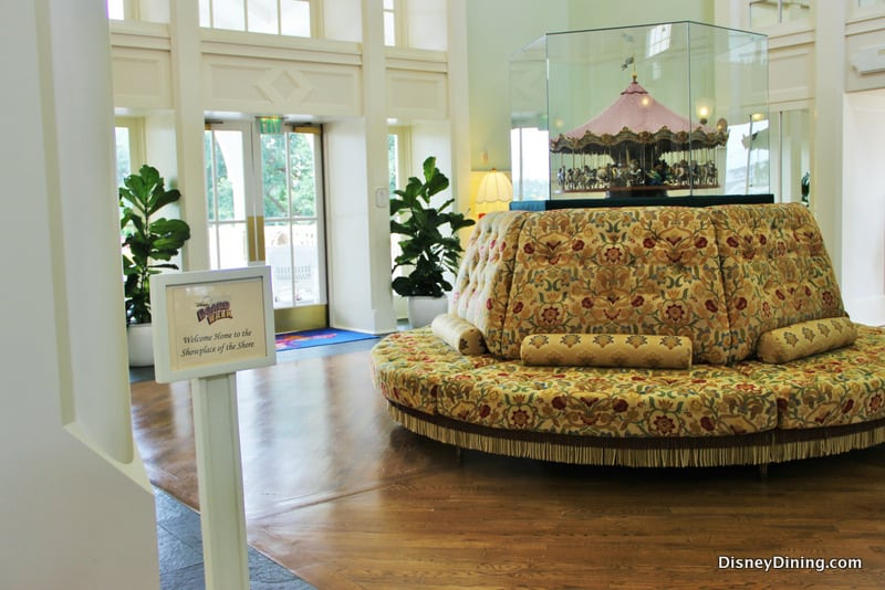 Miniature carousel display on top of round sofa area in lobby ...