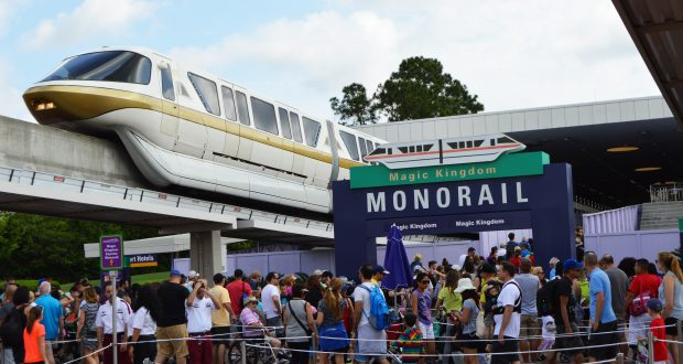 ticket-and-transportation-center-gold-monorail-with-sign-and-line